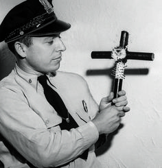 Policeman holding a voodoo cross, New Orleans, Louisiana, 17 June 1949.