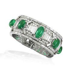 A fine art deco emerald and diamond cuff, by Cartier, circa 1925
