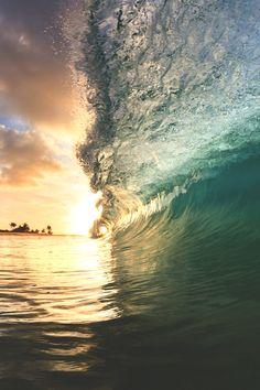 Beautiful sunset through a wave