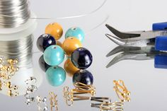 Beads, wire, and pliers are used to make jewelry.