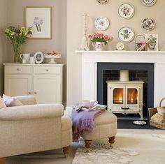 landhausstil wohnzimmer kamin rustikaler couchtisch luftige ...