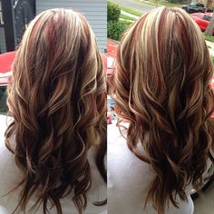 Red highlights with blonde and brown lowlights.