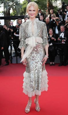 Nicole Kidman arrived at the How to Talk to Girls at Parties premiere (Cannes 2017) in a metallic midi with a keyhole neckline and a tiered skirt by Rodarte, which she paired with bold Harry Winston diamond jewels and matching metallic strappy sandals by Christian Louboutin.