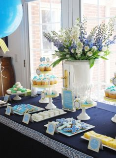 Powder blue themed First Communion dessert table! Desserts/candy/floral arrangement, beautifully matched. We can recreate this for you! http://www.creativeambianceevents.com/ Check out our blog http://www.creativeambianceevents.com/#!blog/c1nl