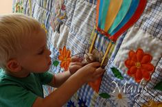 """Patchwork quilt, with applique, baby quilt, tapestry, wall hanging for kids, boys and girls, the SUN (33"""" x 57"""") (85 x 145cm).  On the image there are four pockets with rubber edge – train wagons and balloon basket.  As well as, it's important for the child's development."""