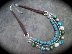 Leather and Pearl necklace with lustrous by HeidiDiCesareDesigns