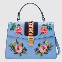 """👜 """"Sylvie"""" embroidered leather top handle handbag from @gucci brightens up winter blues. #fashion #style #flowers #embroidery #purse #handbag #accessories #fleurs #blue"""