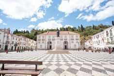 Amazing Day Trip from Lisbon to Tomar Portugal. Photos, tips and advice on Sometimes Home travel blog. Picture of Praca de Republica black and white checkerboard square.