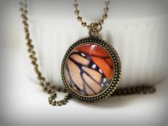 Monarch Butterfly wing necklace - photo pendant necklace - orange and black  antique bronze jewelry. $20.00, via Etsy.