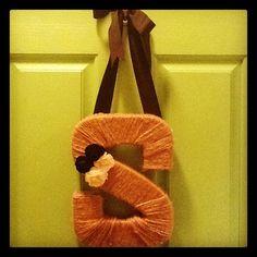Monogram Wreath: paper mâché 3D letter from Jo Ann Fabrics, twine, felt flowers, ribbon, and a glue gun!