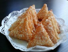Briwat - Morrocan fried phyllo parcels filled with sweet almonds and dipped in honey.