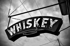 fine art photography  whiskey sign outside bar by ProofOfReality