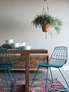 Add a rug and a plant for an instant lift to any room via www.apairandasparediy.com (love those chairs!)