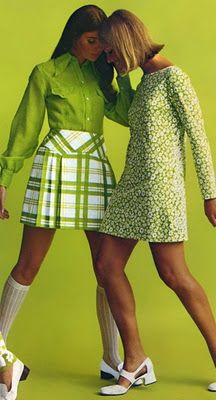 green theme 1960's dress and shkirt and short worn by two short haired women. They are warn above there knee cap/