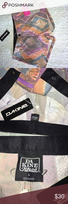 Dakine shorts size 5 I originally bought these at a sample sale for my sister but I didn't get her size right 🙈. They are brand-new classic board shorts size 5. They have a snap and zipper closure with belt loops and mesh pockets. If I could squeeze my size 10 self into these, I would keep them! LOL The pattern is so cute and fabric is Cotton and polyester so you know this will dry quickly. Dakine Shorts
