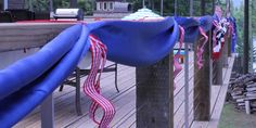 4th of July Deck Decorations Ribbon, Bunting, Flags  (Can use colored shower curtains for same affect.)