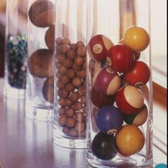Vintage croquet balls, clay marbles and pool balls displayed in vases. Pool Table Room, Man Cave Games, Tall Glass Vases, Pokerface, Game Room Decor, Game Rooms, Party Table Decorations, Poker Chips, Vintage Games