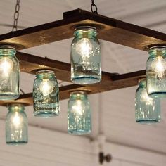 27 Easy and Cheap Hanging Mason Jar Projects #homeadvisorsforhomeimprovementprojects,