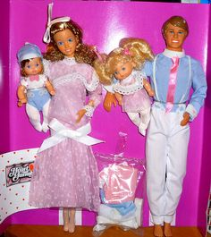 The heart family <3 I loved them! Check out mama's dress. Wow! My dog got ahold of my mama doll and chewed up her hand so I would pretend like she was handicapped. :)