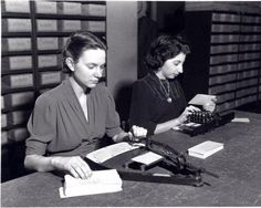 1940 Card Punches Two women working with two types of card punches used to create punch cards.