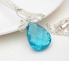Sky blue quartz necklace, wire wrap jewelry, handmade light blue necklace silver wire wrap aqua blue briolette necklace. $65.00, via Etsy.