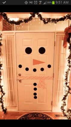 Cute door decoration ... thinking elf on the shelf may do this to the kids rooms...