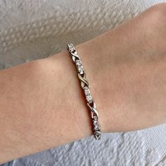 Rhinestone Bracelet Rhinestone bracelet. Perfect condition, no stones missing. Secure clasp with hooks, sometimes the hooks seem a little loose, still secure but can be fixed. Macy's Jewelry Bracelets