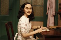 A wax figure of Anne Frank and their hideout reconstruction  is unveiled at…