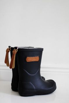 Bisgaard Boots - I wish they made these wellies for adults! Also, they got rid of the leather logo on the boot... now it's all rubber except for the the tag in the back. :\