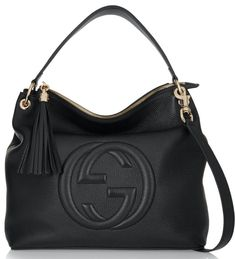 New & Vintage Gucci Up to 70% Off Retail. Real or Your Money Back. Shipping & Returns Included. Condition: Brand new with cards and dust bag Brand: Gucci 100% Authentic Made in Italy 'Soho Hobo' shoulder bag is embossed with the label's 'GG' logo and finished with a playful tasseled zip pull. Crafted in Italy from supple textured-leather and lined in canvas, this sizable accessory will easily hold your tablet, wallet and cosmetics pouch. Carry it by the detachable shoulder strap. Texture Gucci Shoulder Bag, Shoulder Handbags, Leather Shoulder Bag, Shoulder Strap, Shoulder Bags, Black Shoulder Bag, Black Leather Messenger Bag, Black Leather Handbags, Gucci Handbags