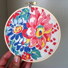 vintage fabric in an embroidery hoop   Easy and cute