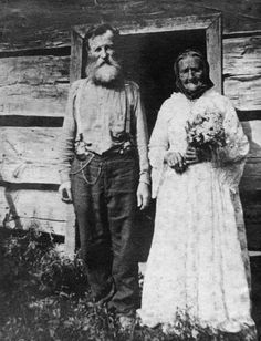 Appalachia - looks like a late-life marriage - perhaps a widow and widower? At least she got to wear a pretty dress for awhile, but she probably ended up making them dinner that night and bringing in the wood! Vintage Pictures, Old Pictures, Old Photos, Family Pictures, Appalachian People, Appalachian Mountains, Museum Studies, We Are The World, Mountain Man