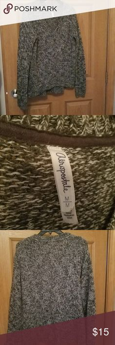 Aeropostale black and white, high low sweater Very thick, warm sweater. Warm a handful if times last winter in excellent condition no pulls in the fabeic. Aeropostale Sweaters V-Necks