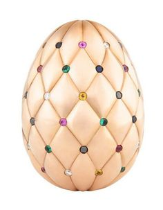 The Diamond Jubilee Egg - Crafted with precisely 500 grams of rose gold, the design of this 1-of-a-kind prize is based on Fabergé's much loved Matelassé jewelry collection. It features 60 gemstones - 1 for each year of Her Majesty The Queen's reign, set in the pleats of its quilted rose gold surface & comprising diamonds, emeralds, rubies & sapphires. The Diamond Jubilee Egg, valued at £ 100,000, is the supreme prize in the world's most prestigious Easter egg hunt. Wouldn't you love to find it?