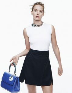 Jennifer Lawrence models a chic black and white outfit, statement necklace, and purple purse // Photo c/o Dior
