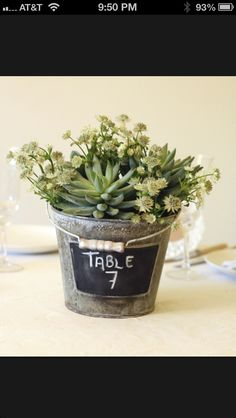 A small bucket can also be a nice idea for a table arrangement. If you fill the bucket with soil and fresh plants or flowers, you can use them as table decorations for special events. To make it easier to organize them you can label them with chalkboard paint.