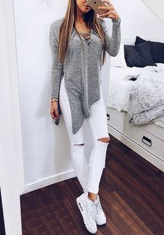 Grey side-slit asymmetrical tee, white ripped jeans and white sneakers