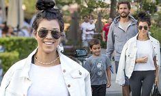 Kourtney Kardashian coordinates in grey with ex Scott Disick and Mason