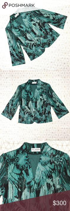 """St. John evening shiny blazer/jacket - Size: tags were removed but this is believed to be size 8. See measurements below - Material: N/A - Condition: excellent  - Color: blue (close to a darker robins egg blue), black. Colors in photos are the best representation of the color - Pockets: no - Lined: no - Closure: front zipper  - Style: shiny evening blazer/jacket, really cool - Extra notes: truly a unique piece. Has shoulder pads  *Measurements:  Bust: 19"""" flat Waist: 18"""" flat Length: 23.5""""…"""