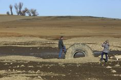Folsom, Calif. Visitors take photographs at the bottom of Folsom Lake, which is at 17 percent of its capacity, in Folsom, Calif., Jan. 22, 2...