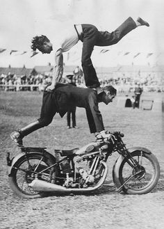 circa 1935: Members of the Royal Signal Corps demonstrate their skills at the Motorcycle Gymkhana at the Great Barking Carnival in London. (Photo by Fox Photos/Getty Images)