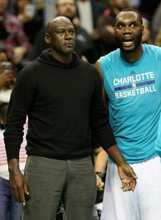 Michael Jordan Photos Photos - (L-R) Owner of the Charlotte Hornets, Michael…