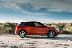 Turning red at the beach? Not a problem! #AudiQ2 #red