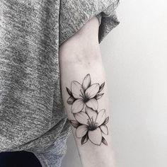 Lilies by Helen.  @helenxu_tattoo  #thefineartfactory #teamgoldeniron #goldenirontattoostudio