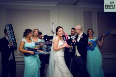 Chaos as the bridal party band decide what song to play on air guitar! Weddings at Druids Glen Resort photographed by Couple Photography www.couple.ie