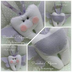 Lindos dentinhos para colocar o dentinho de leite do seu filho, com bolsinho para deixar o dente e receber a moedinha.  Com fitinha para pendurar