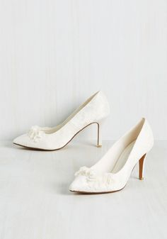 Ornate Occasion Heel. Amid lush floral arrangements and sparkling chandeliers, these ivory heels fete in with your opulent surroundings while still standing out! #white #wedding #bride #modcloth