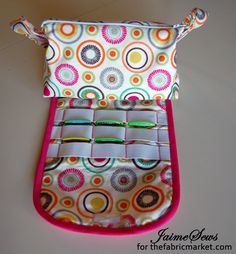See how the cosmetics bag with brush roll pattern was adapted to hold computer games and cartridges.  Genius!
