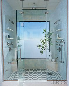 Love the outdoor open feel to this. Rain head shower and dual heads...AWESOME!! Perfect design, consider expanding seating area in center.