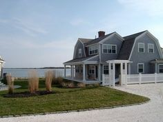 Cape Cod Style Home - gorgeous! All but the roof. I don't want to live in a barn :)